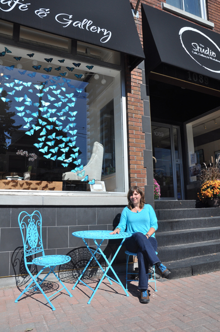 """Local artist Patti Normand created a display of handpainted butterflies in memory of her mother. She calls it """"grief-itti."""" Photo by Andrea Tomkins"""