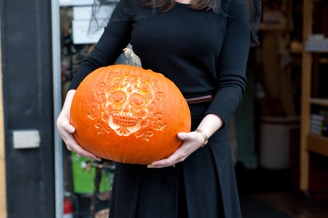 Kitchenalia Assistant Manager Jade Cummings, holds their prize-winning pumpkin. Photo by Kate Settle.