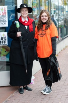 Cassia Skiggs with Mary Poppins (aka Shannon Macfarlane) welcome trick-or-treaters to Mrs. Tiggy Winkles.