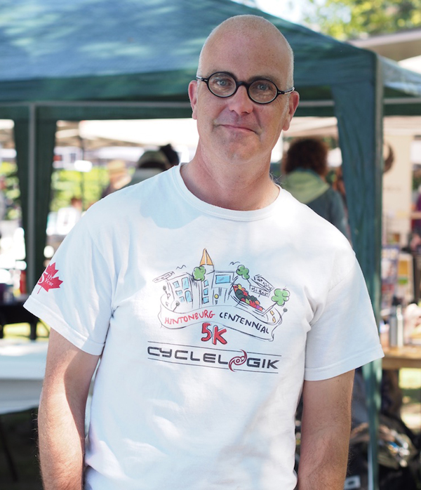 """It's a success by any measure. I've seen hundreds of people. I've talked to authors and all day and they seem to be moving books. The author panels have been really well-attended. The park is the perfect size for this event and I'm looking forward to having this at Parkdale Park for years to come,"""" said Councillor Jeff Leiper. Photo by Pearl Pirie."""