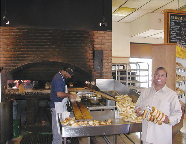 Pyare Sharma at the Kettleman's Bagel franchise on Carling Avenue. Photo submitted by Ranjeev Sharma