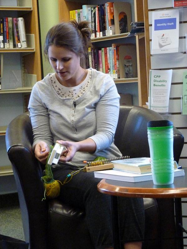 "Carlingwood Library Knitting Club founder Kelly Wojnarski. ""I'm hopeless with needles,"" she explains as she demonstrates the two knitting machines she's using to make socks."