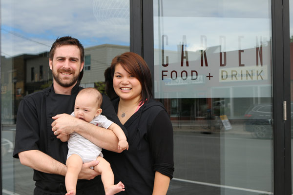 Carben Food + Drink owners Kevin Benes and Caroline Ngo with their son Kai in front of their restaurant at 1100 Wellington St. W.