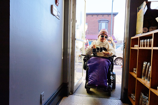 Chris Binkowski from Accessibility for Humanity tries out the new ramp at House of Barons. Photo by Ellen Bond
