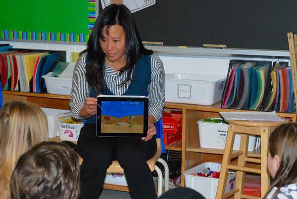 Evelyn Eldridge testing her math app with students at Churchill P.S. Photo by Andrea Douglas