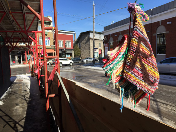 "The Rosemount Avenue Branch of the Ottawa Public Library was ""yarn bombed"" on March 14. Knitters from across Kitchissippi Ward and the city created over one hundred and seventy-five knitted books and hearts to illustrate their love for the library. Photos by Andrea Tomkins"