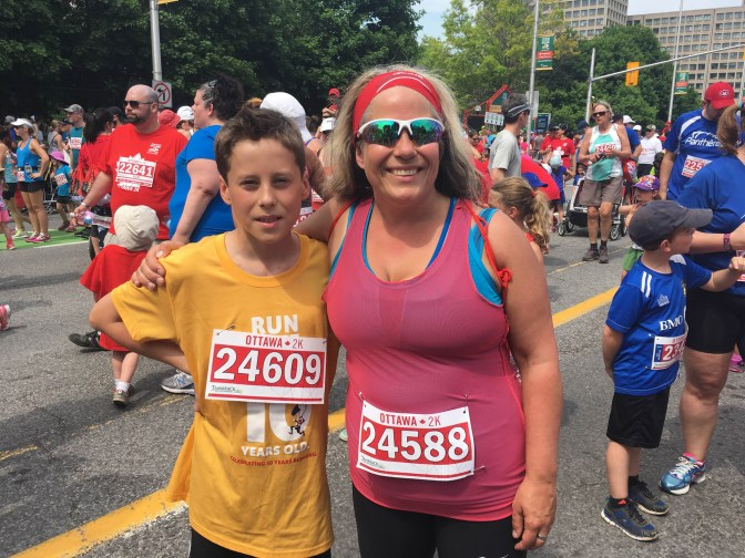 Lisa Georges is the race director for the Cyclelogik HintonburgCentennial 5K Run/Walk & Newswest 1K Kids' Run, which is taking place July 10. She's pictured here with her son Evan.