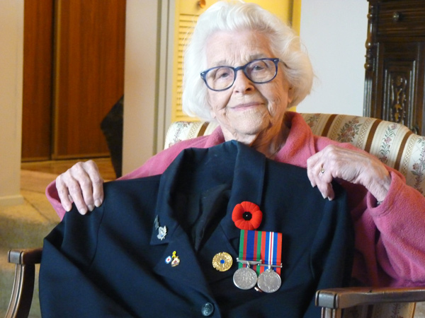 Elsa Lessard with her uniform and medals earned during World War II. Photo by Judith van Berkom