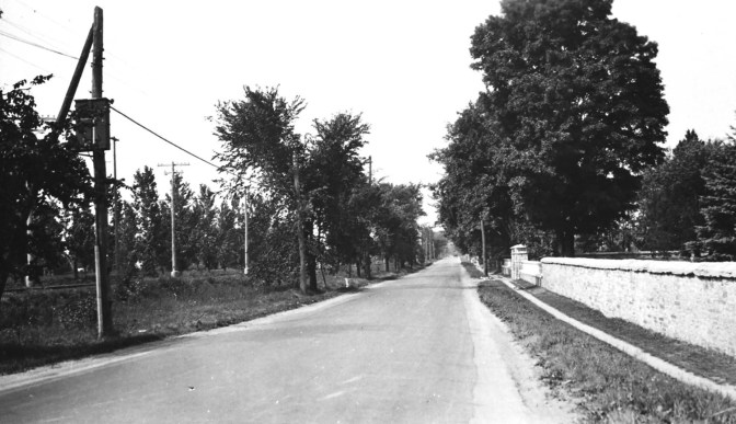 This photograph of Richmond Road from the 1920s shows the distinctive Maplelawn stone wall before Richmond Road was widened in 1931.  Photo courtesy of the City of Ottawa archives (CA-7595)