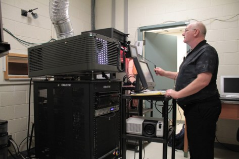 Projection operator Julian Gumley works the 3D projector, which OFC operators say is one of the best in Ottawa.