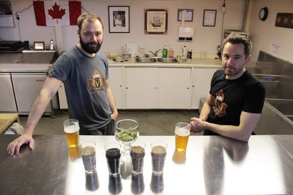 Mike and Kevin Sirko showcase the grains and hops that go into making their beer. Photo by Jacob Hoytema