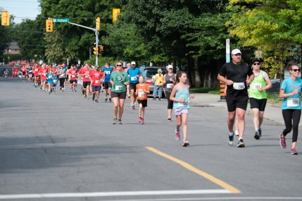 A line of runners as far as the eye can see down Spencer Street.