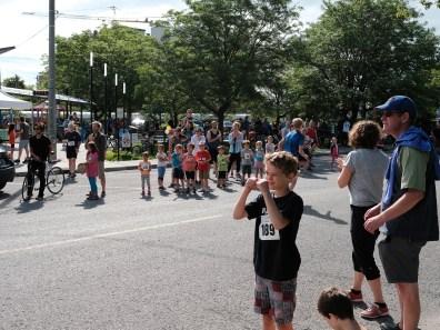 Fun Run participants stick around to cheer on their elders.
