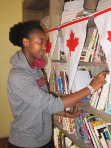 Immaculate, 15, was born in Congo and lived in Kenya for seven years before moving to Canada with her family. It was here that she really became a reader. Photo by Andrea Prazmowski