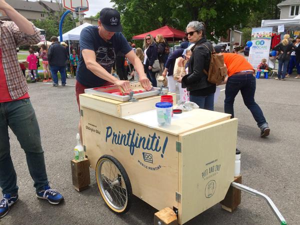 Jamie McLennan demonstrating Printfiniti! at Westfest this past June. Photo by Andrea Tomkins