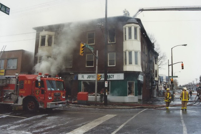 A photo of the Joynt's Pharmacy/Goldwyn Apts building on fire in December 1996. Photo courtesty of Ian McCord