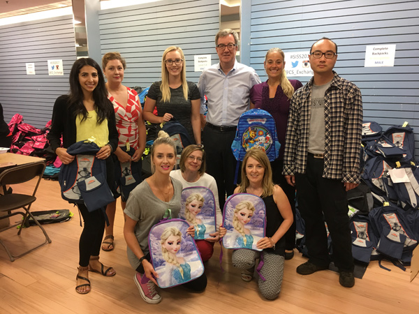A team of-volunteers from service coordination for people with developmental disabilities pose with Mayor Jim Watson.