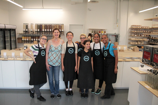 """The management and employees of Nu Grocery gather for a group photo on their """"soft"""" opening day, which was heavily attended despite heavy rain. (L-R): Sia Veeramani, Valérie Leloup, Khema Stein, Kylie Shaw, Faezeh Khatami, Jasmine Acharya, and Sarah Parker. Photo by Jacob Hoytema"""