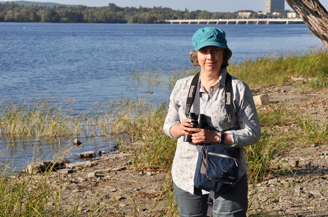 Kitchissippi's Bev McBride leads birding excursions for the Ottawa Field-Naturalists Club. She's pictured here on the shores of the Ottawa River, which is part of an internationally designated Important Bird and Biodiversity Area (IBA). Photo by Andrea Tomkins