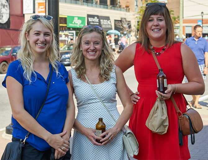 """""""We work in the area and wanted to check out the event. We're enjoying this great kombucha-infused sangria from the Herb & Spice Shop on Wellington St. W.,"""" says Ashley Harris (right). She's pictured here with Alexandra Martin (left), and Kerry Johnston (centre)."""
