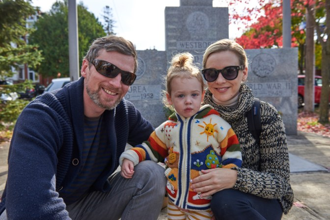 """Patrick and Eliza Rossiter, with Neve (in the centre): """"Our favourite part of the market is people watching. We love getting fresh produce and not having to leave the city for it."""""""