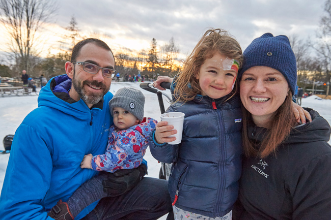 """""""We were walking by as we live in the neighbourhood. The fire and the face painting drew us in. We ran into friends from school too,"""" says Jamie and Sarah Messel."""