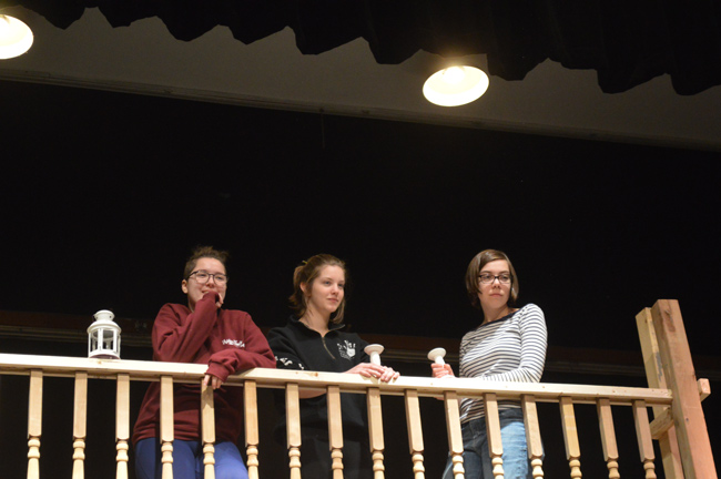 Nepean High School students Megan Clark, Tess Martin, and Clara Austrins during rehearsals for The Addams Family musical.