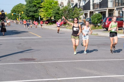Jane Latham (left) waving to the crowd along side, Maddy Zarull (centre) and Trillium Whitewolf (right)