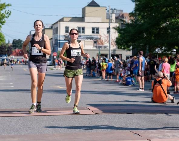 Stephanie Edwards (left) and Jane Latham (right) finish in unison