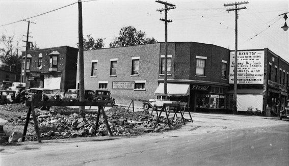 This photo from 1935 shows the original businesses on this corner, but also highlights the 14' that would get sliced off the front of this building 1939. It also shows the curved corner, as it still stands today, which was the creation of Benjamin Bodnoff. Photo courtesy of the City of Ottawa Archives, CA-7611.