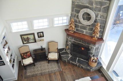 Looking downstairs at the fireplace. Photo by Andrea Tomkins