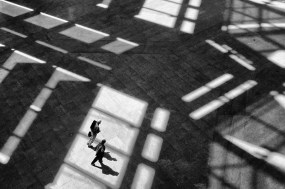 Two figures walking in sunlight by Suellen Seguin