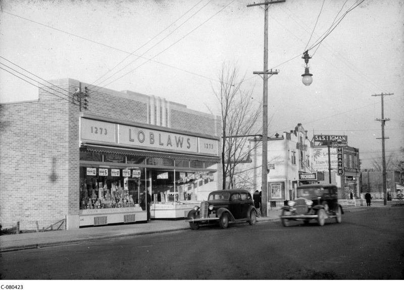Loblaws, Victoria Theatre and Higmans on Wellington (now St Vincents, apt building and Thyme & Again) (Library Archives Canada, C-080423)