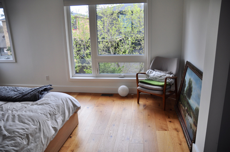 View of the bright master bedroom. Photo by Andrea Tomkins
