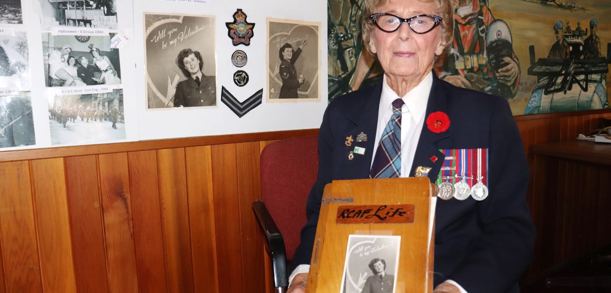 Connie Mooney rakes some of her artifacts from her time serving during World War II to commemorate Remembrance Day.
