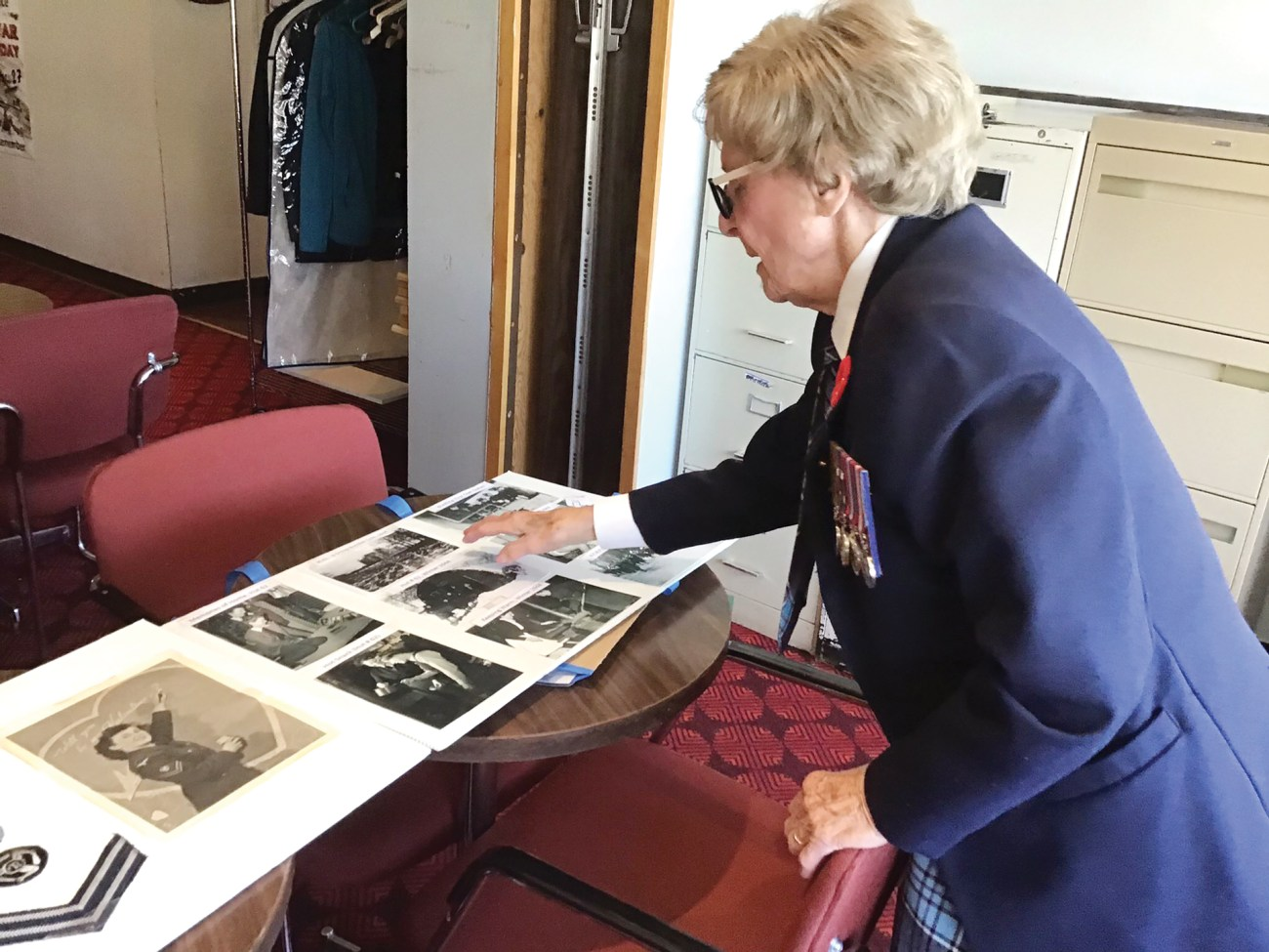 Connie Mooney looks at some of her old photos from her time serving during World War II to commemorate Remembrance Day.