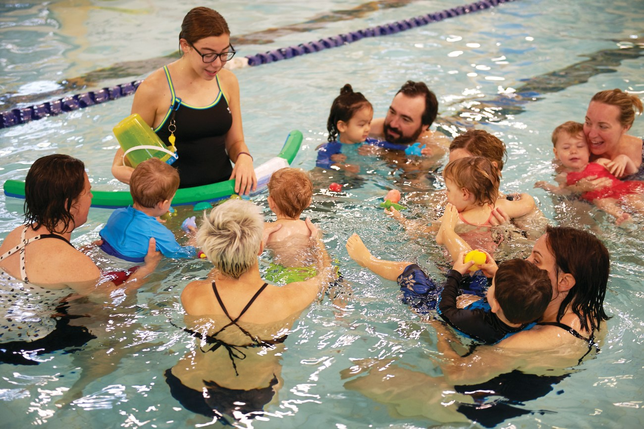 Kids and adults during swimming classes at Dovercourt pool.