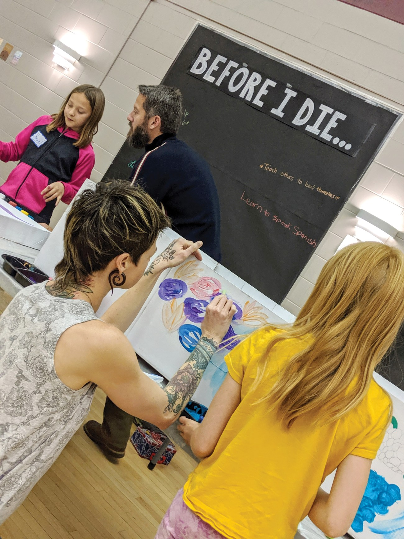 Visitors to the Deathcare Expo, including kids, were able to personalize a cardboard casket with paint and try their hand at building a grief mandala.