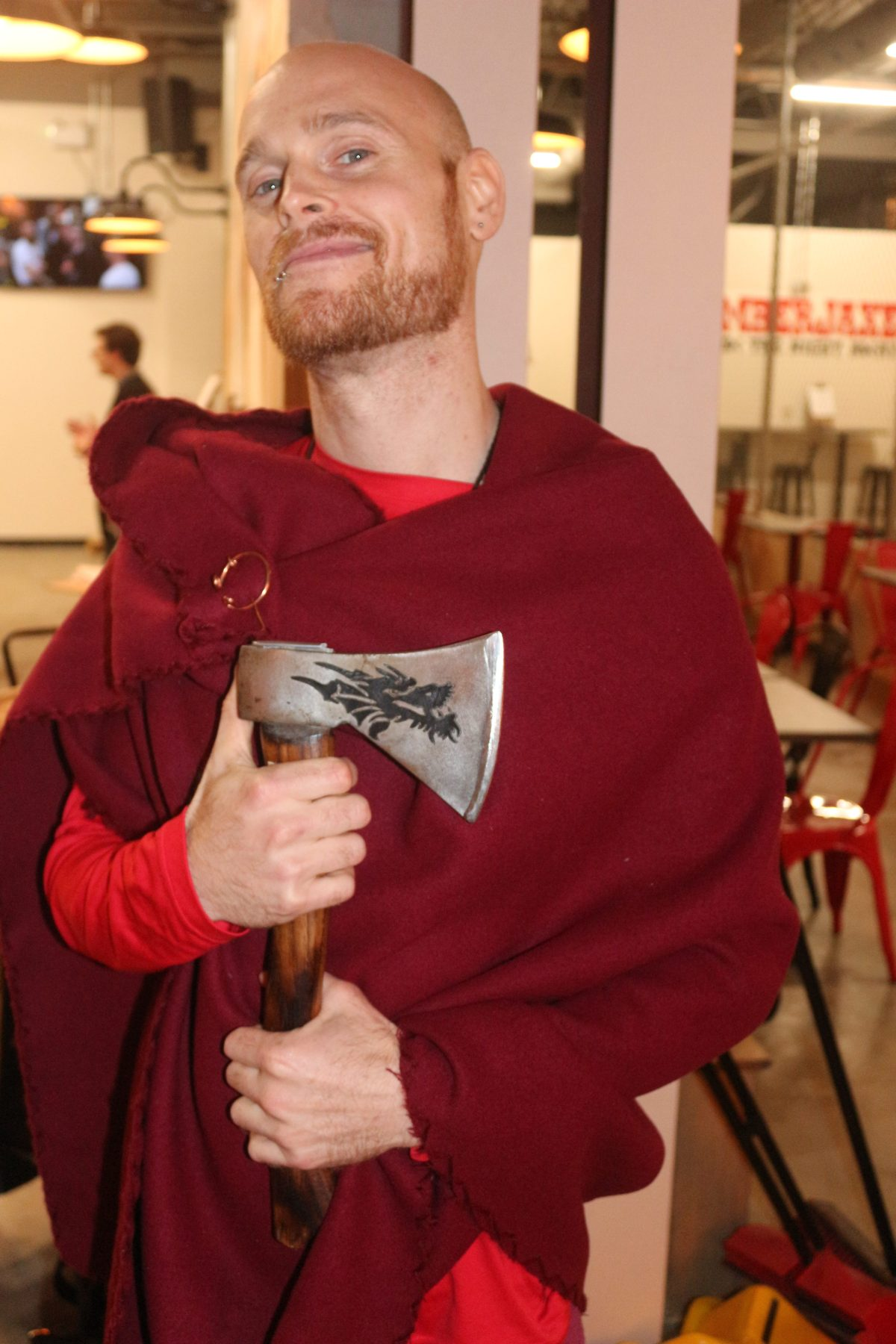 Sysafey Vennon, one of the staff at Lumberjaxe, poses with an axe.