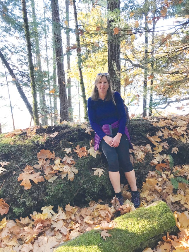 Meghan Maack, who works with Cuso, takes a break from an autumn hike in Ottawa.