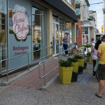 Customers wait outside Mamie Clafoutis after the local bakery re-opened. Photo by Ellen Bond.