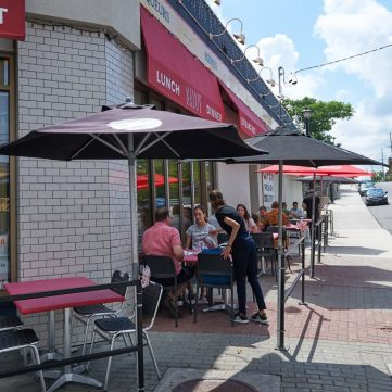 Customers enjoy the sunshine on the patio at Savoy Brasserie in Kitchissippi. Photo by Ellen Bond.