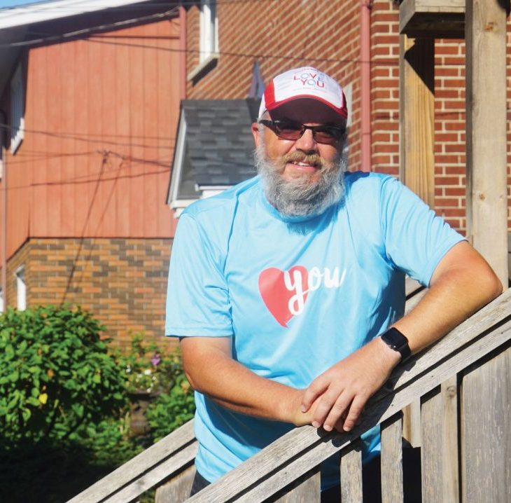 A photo of Marc Gagnon arriving at home in Hintonburg after his 24 hour walk for mental health.