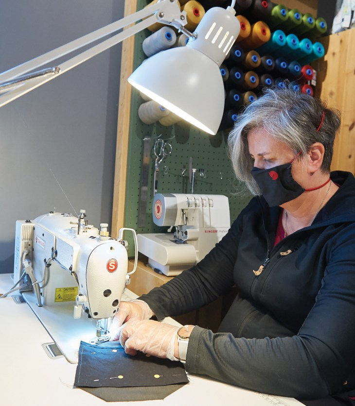 A photo of Cindy Jones sewing a mask in Westboro.