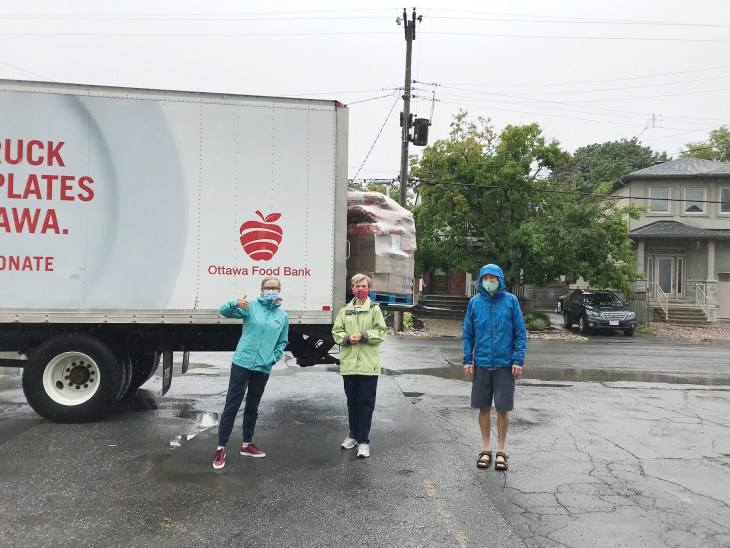 A photo of the food bank volunteers outside in Westboro in front of a food delivery truck,