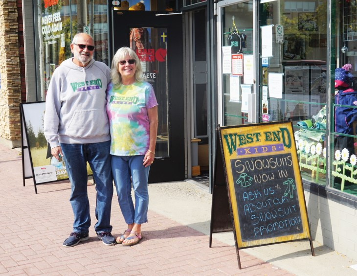 A photo of West End Kids owners Gordie and Sheba Schmidt standing outside their Westboro store.