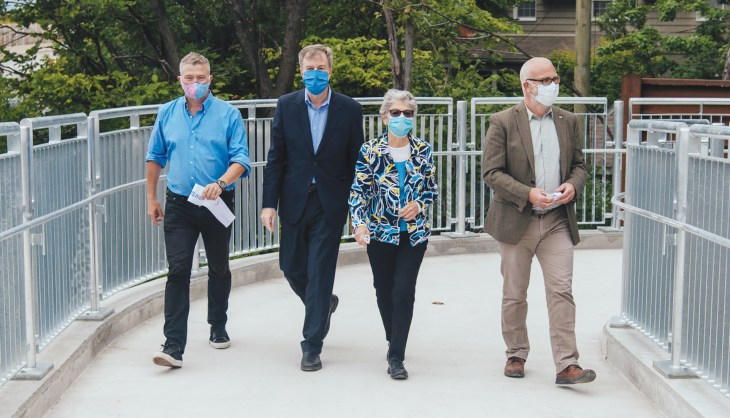 Councillors, the mayor and former mayor take a walk on the Jackie Holzman Bridge.