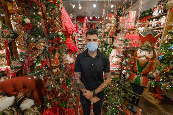 Audy Czigler stands in the middle of a decorated Tinseltown store in Hintonburg.