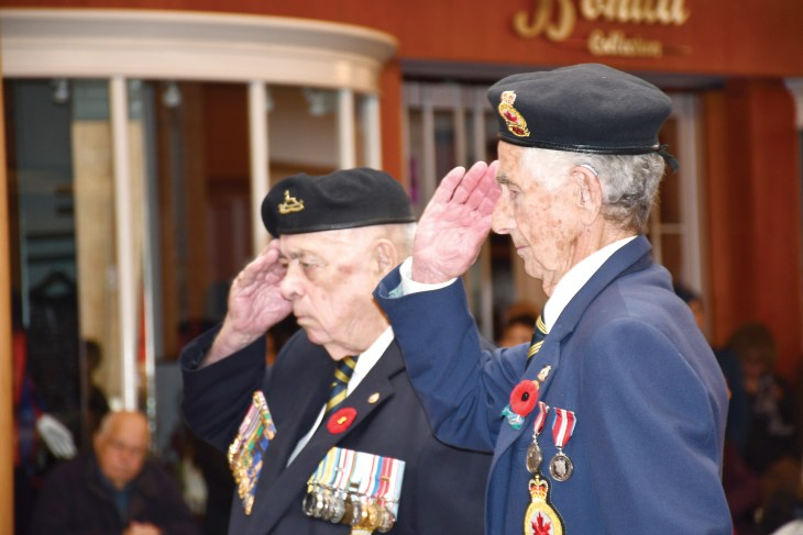 Two veterans saluting at the Carlingwood Mall Remembrance Day ceremony in Ottawa on Nov. 11, 2019.