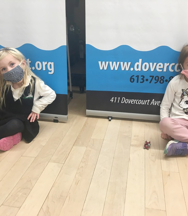 Two children in masks sit in a Dovercourt class in November.